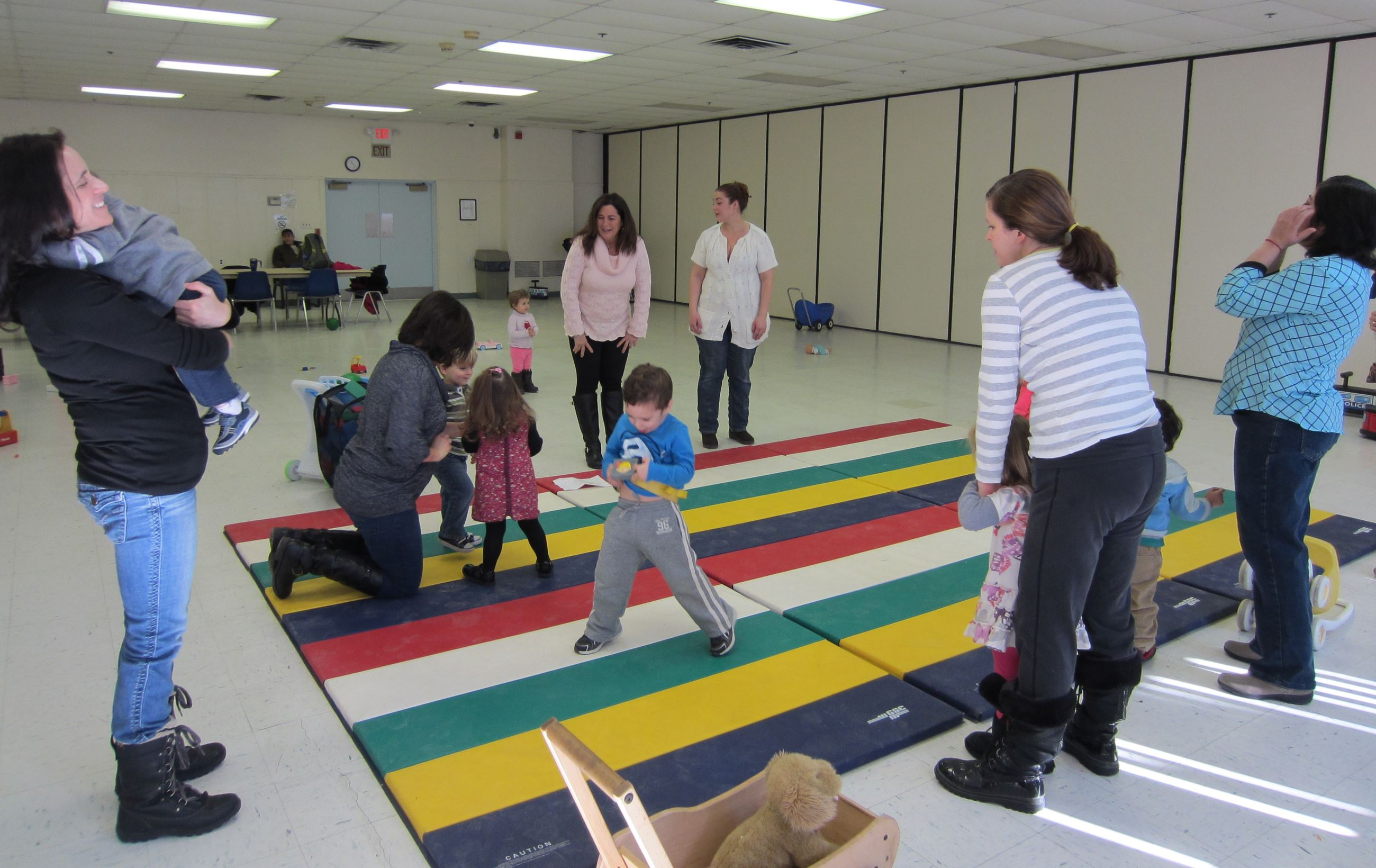Toddlers accompanied by a Mom, Dad, Grandparent or Babysitter Enjoy Playing and Making New Friends